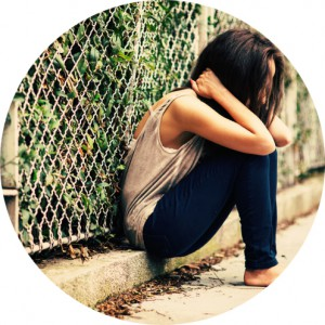 depressed girl sitting alone