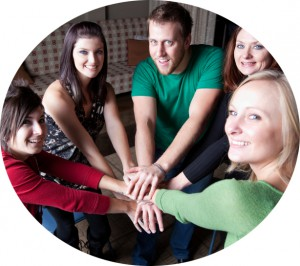 group of friends holding hands in a circle