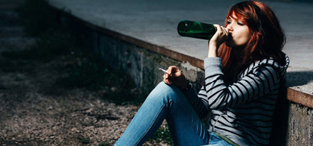teen girl drinking alcohol alone