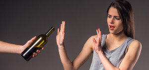 woman saying no to alcohol